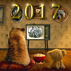 レトロなテレビをテディベアと見る小熊。その上にゴールドに輝く2017の文字